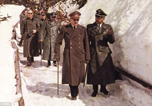 Himmler (pictured with Hitler at Berchtesgaden)